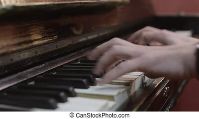 Man playing melody on piano by both hands. Professional musician. Talent. Black and white keys.