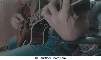 Man playing music on acoustic guitar