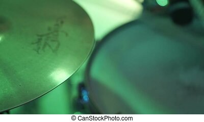 Man playing music on drums at concert