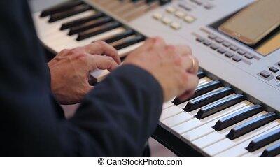 Man playing music on keyboard