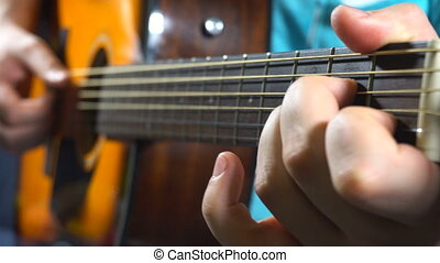 Man playing on acoustic guitar - Man with pleasure playing...