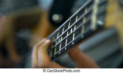 Man Playing On Bass Guitar