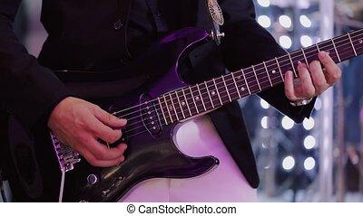 Man Playing on Electric Guitar