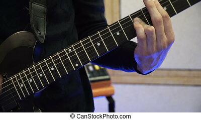 Man Playing on Electric Guitar. Slow Motion Instrument Playing Band of Men