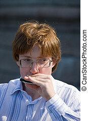 man playing on harmonica