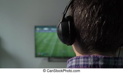 Man playing on the joystick in a game console.