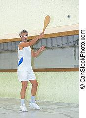 man playing pala