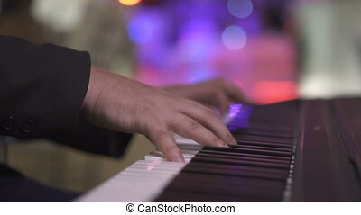 Man playing piano outdoor - Closeup man hands playing piano...