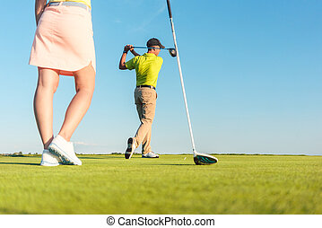 Man playing professional golf with his partner during matchplay