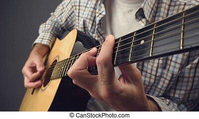 Man playing punk rock on guitar