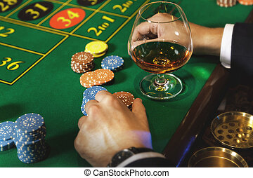Man playing roulette in the casino