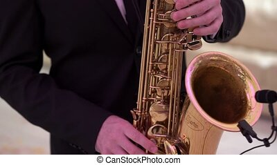 Man playing saxophone at the party event or celebration. -...