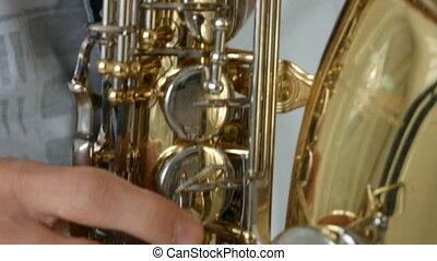 Man playing saxophone close up
