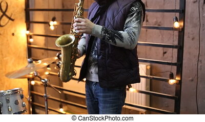 Man playing saxophone on concert