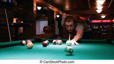 Man playing snooker in night club 4k - handsome man playing...