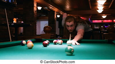 handsome man playing snooker in night club 4k