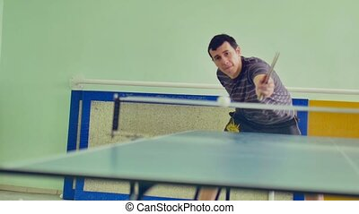 man playing sport athlete table tennis slow motion video backhand