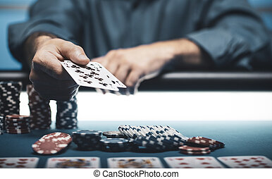 Man playing Texas Hold 'em poker at Casino, he is holding ...