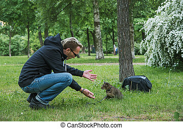 man playing the cat outdoor
