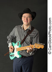 man playing the electric guitar