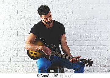 Man playing the guitar