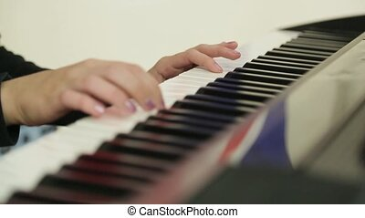 man playing the piano close up