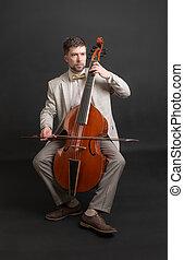 man playing the viola da gamba