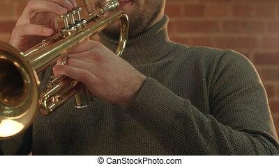 Man Playing trumpet.