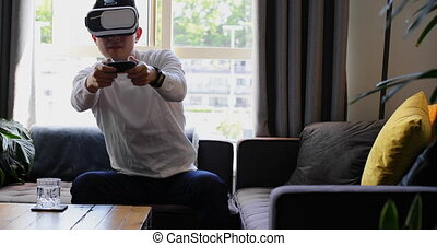 Man playing video games with virtual reality headset 4k
