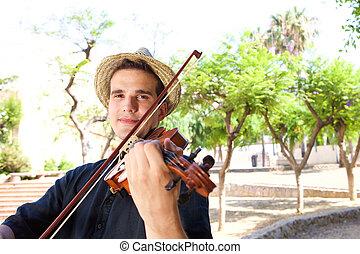 Man playing violin outside