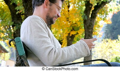 Man playing with cell phone