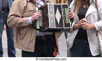 man playing with vintage accordion