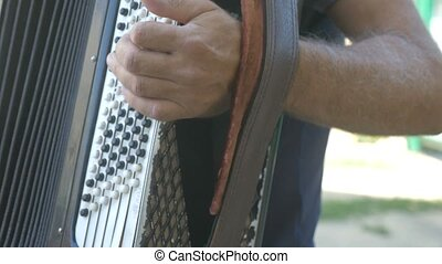 man plays accordion video