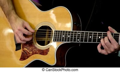 Man plays acoustic guitar - Man plays the acoustic guitar