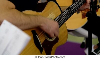Man plays acoustic guitar - Man plays the acoustic guitar