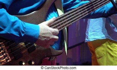 Man plays bass guitar