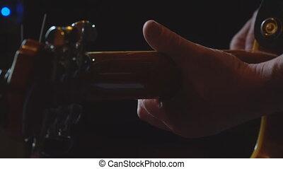 Man plays guitar in a dark room - A man plays guitar in a...