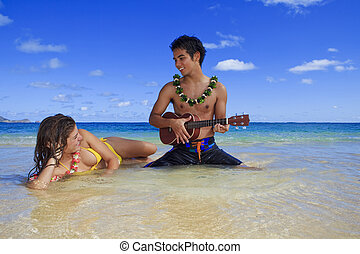 man plays his ukulele for a young woman
