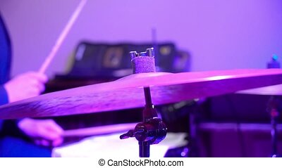Man plays musical percussion instrument with sticks closeup...