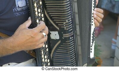 man plays the accordion video