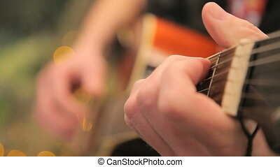 man plays the acoustic guitar