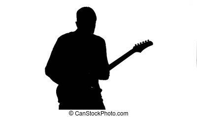 Man plays the melody on the guitar. Silhouette