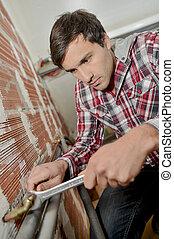 Man plumbing his house