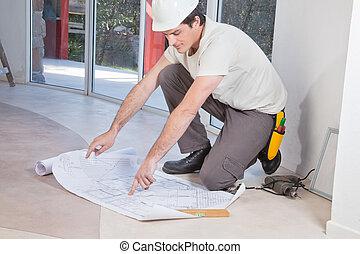 Man pointing at blueprint