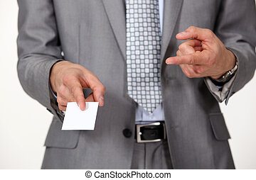 Man pointing at business card