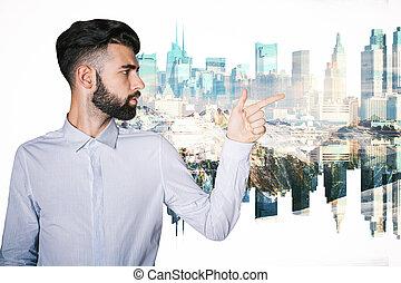 Man pointing at city