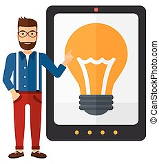 Man pointing at tablet computer with light bulb on screen.