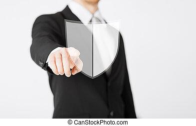 man pointing finger at antivirus program icon