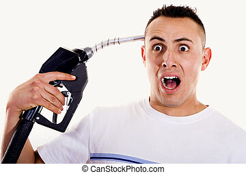 Man pointing fuel nozzle at his head - Stock image of man...