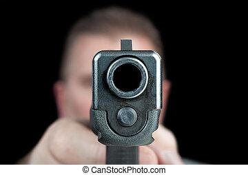 Man pointing gun - A man aims his semi automatic pistol....
